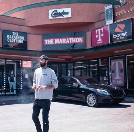 Nipsey Hussle in front of his clothing store 'Marathon Clothing'.